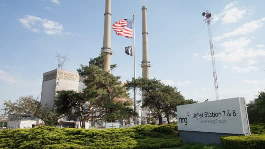 An American flag hangs in front of NRG Energy's Joliet Station power plant, May 7, 2015, in Joliet, Ill.
