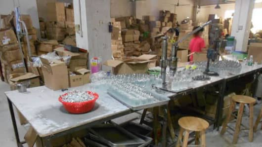 Inside a counterfeit perfume factory