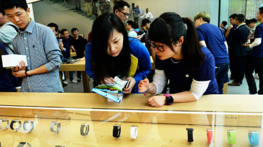 Customers look at the Apple Watch in Hangzhou, China.