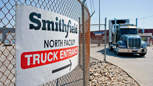 Trucks make their way around the Smithfield Foods packaging plant in Smithfield, Virginia.