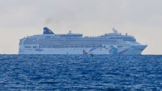 In this photo provided by the Royal Gazette, the Norwegian cruise ship Norwegian Dawn, lies aground near Bermuda's North Channel Tuesday, May 19, 2015.