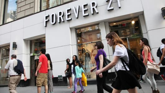 Pedestrians pass in front of a Forever 21 store in New York.