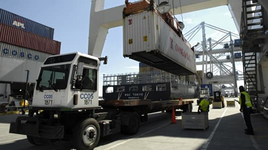 A shipping container at the Georgia Ports Authority Garden City Terminal is loaded aboard a ship in Savannah, Ga.