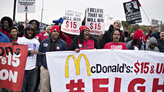 Demonstrators march near McDonald's headquarters in Oak Brook, Illinois, U.S., on May 20, 2015