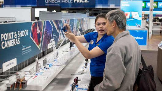 A customer gets help from an employee at a Best Buy store in San Francisco.