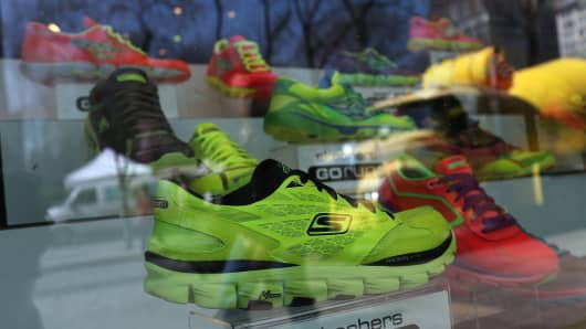 Shoes are displayed in the window of a Skechers store in New York City.