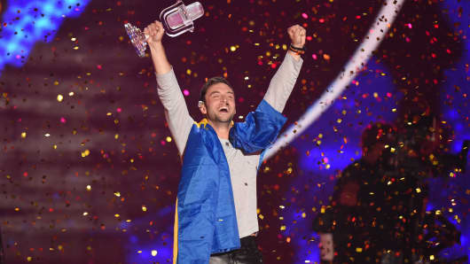 Mans Zelmerloew of Sweden reacts after winning on stage during the final of the Eurovision Song Contest 2015 on May 23, 2015 in Vienna, Austria.