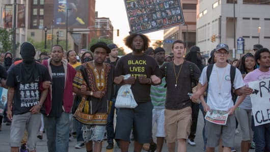 People take to the streets and protest in reaction to Cleveland police officer Michael Brelo being acquitted of manslaughter charges after he shot two people at the end of a 2012 car chase in which officers fired 137 shots May 23, 2015 in Cleveland, Ohio.
