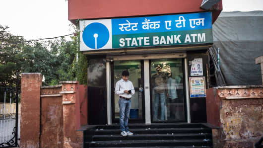 A customer is seen outside the State Bank ATM in Jaipur, Rajasthan, India.