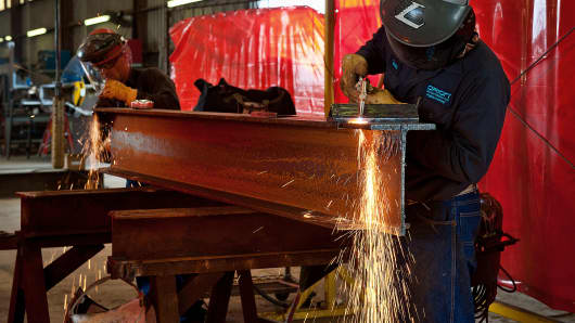 Welders cut beams for the substructure of a new oil and gas drilling rig at the Orion Drilling Co. manufacturing and fabrication facility in Corpus Christi, Texas.