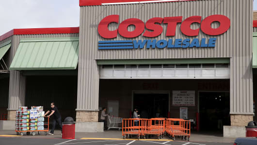 A customer leaves a Costco store in Richmond, Calif.