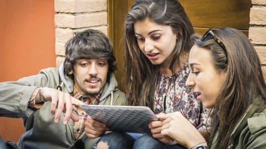 Millennials watching ipad