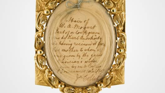 Lock of Wolfgang Amadeus Mozart's fair hair, contained in a nineteenth-century gilt locket.