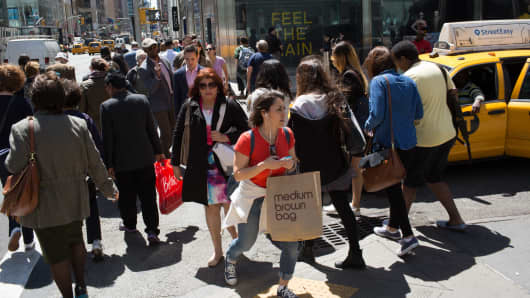 Shoppers walk along Lexington Avenue in the eastern Midtown section of Manhattan in New York City.