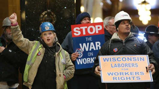 Wisconsin laborers chant 'Union Strong' during a rally inside the Wisconsin State Capitol as the State Assembly debates the right-to-work bill in Madison, on March 5, 2015.