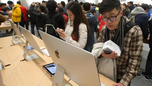 People experience in new Apple Store at Jiefangbei in Yuzhong District on January 31, 2015 in Chongqing, Sichuan province of China.