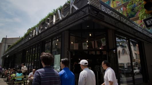 People walk past a Shake Shack Inc. restaurant in Philadelphia.