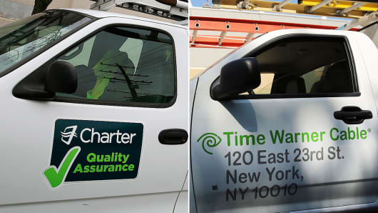 Charter Communications and Time Warner Cable trucks.