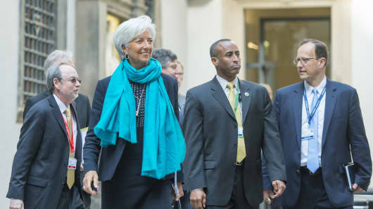 Managing Director of International Monetary Fund (IMF), Christine Lagarde (2nd L),arrives for the symposium 'Towards a Dynamic Global Economy' during G7 summit of finance ministers at Palace Chapel of Residenzschloss in Dresden, eastern Germany, on May 28, 2015.