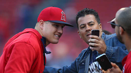 Mike Trout #27 of the Los Angeles Angels takes a picture with fans before a game with Boston Red Sox at Fenway Park on May 23, 2015 in Boston, Massachusetts.
