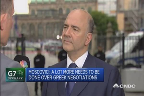 Dedicated to keeping Greece in EU: Moscovici