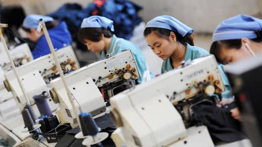 This photo shows workers producing clothes in a factory in Huaibei, east China's Anhui province.
