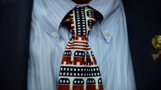 A tie decorated with the elephant mascots of the Republican Party.