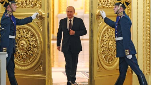 Russian President Vladimir Putin enters the St. George Hall at the Grand Kremlin Palace in Moscow.