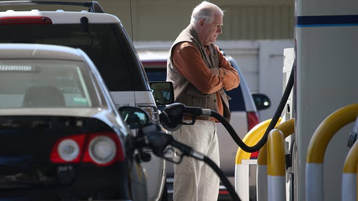 A customer pumps gasoline into his car at an Arco gas station in Mill Valley, California.