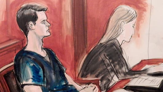 In this courtroom sketch, Ross William Ulbricht is seated in court and awaits sentencing Friday, May 29, 2015 in New York. The San Francisco man who created the online drug-selling site Silk Road was sentenced to life in prison by a judge who cited six deaths that resulted from drugs bought on his website and five people he tried to have killed.