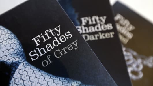 Paperback editions of the 'Fifty Shades' trilogy by E.L. James.The fourth book in the series is set to publish in June, 2015.