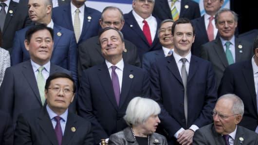 ECB President Mario Draghi, center, George Osborne, U.K. finance minister, right, Lou Jiwei, China's finance minister, bottom right from left, U.S. Fed chair Janet Yellen and Wolfgang Schaeuble, Germany's finance minister,