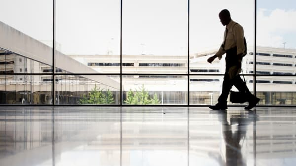 A file photo of a man walking through a terminal at the Philadelphia International Airport.