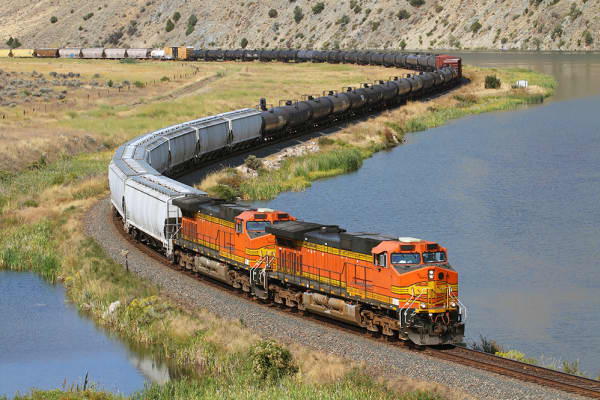 An eastbound manifest freight swoops through a S curve in Lombard Canyon just east of Toston, Montana.