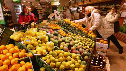 Shoppers chose from organic fruits and vegetables at a supermarket.