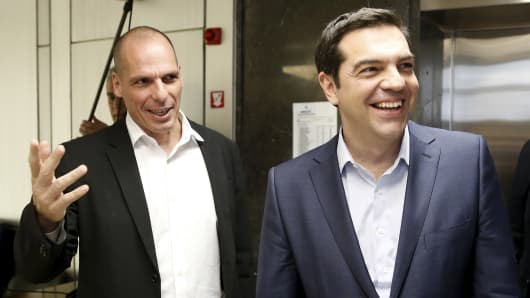 Greek Finance Minister Yanis Varoufakis (left) welcomes Prime Minister Alexis Tsipras for a meeting at the ministry in Athens on May 27, 2015.