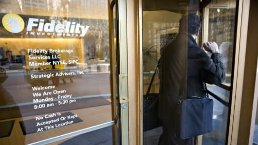 A man exits a Fidelity branch in New York.