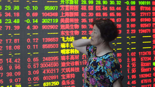 An investor observes stock market prices on May 26, 2015 in Hangzhou, China.