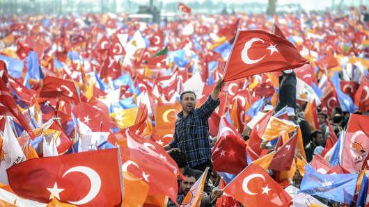 Supporters of the AK Party (AKP) flags during an election rally.