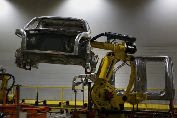 A robot moves a 2015 Ford Motor Co. F150 truck on the production line at the company's Dearborn Truck Assembly facility in Dearborn, Michigan.