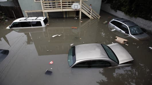Submerged cars resulting from a water main break in Los Angeles in February.