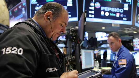 Traders work on the floor of the New York Stock Exchange (NYSE) on June 8, 2015 in New York City.