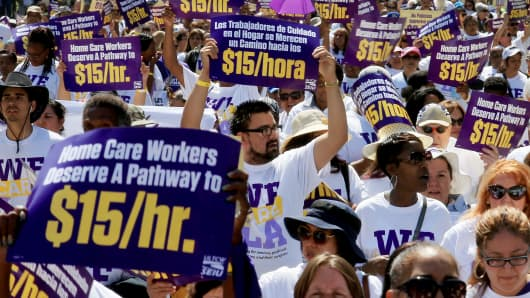 More than a thousand L.A. County homecare workers march downtown to call for a hike in the minimum wage to $15 per hour on Tuesday, April 14, 2015, in Los Angeles.