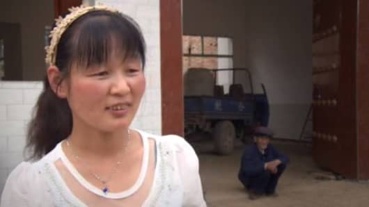 Wang Li, grocer and 'stock market goddess' in Nanliu village.