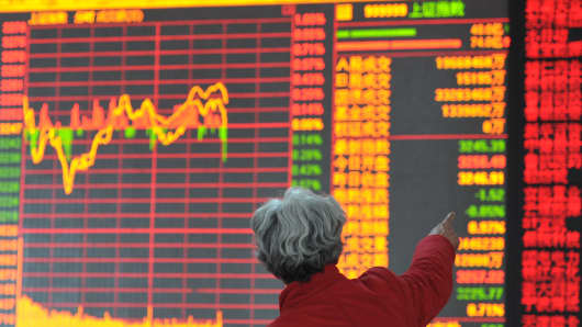 Shareholders on a security trading floor in Shenyang, China.