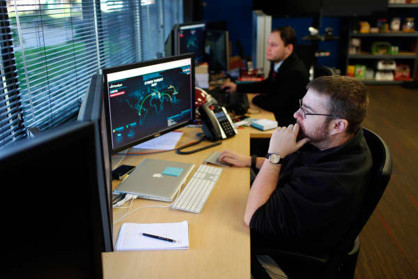 FireEye information analysts work at the company's office in Milpitas, California.