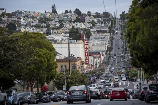 Cars drive down Castro Street in San Francisco, California, U.S., on Thursday, May 7, 2015.