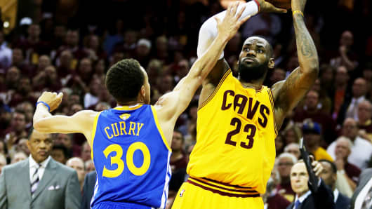 LeBron James of the Cleveland Cavaliers shoots against Stephen Curry of the Golden State Warriors during Game Three of the 2015 NBA Finals on June 9, 2015 in Cleveland.