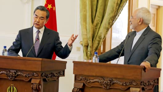 Chinese Foreign Minister Wang Yi, left, and Iranian Foreign Minister Mohammad Javad Zarif hold a press conference following a meeting in Tehran, Iran.