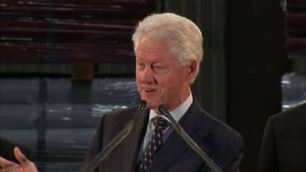A pay cut for Bill Clinton